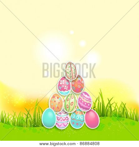 Bright Easter holiday background. Painted eggs on green grass with place for text.