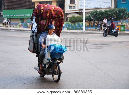 Man On The Motorcycle Carrying Items In Hanoi, Vietnam