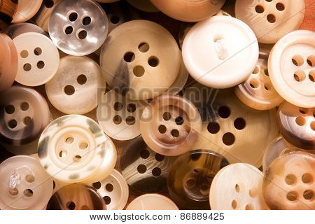 Clothing buttons. Buttons scattered on a sewing or work table.