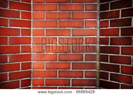 Red brick corner with slanted walls. fireplace or inside a chimney.
