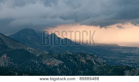 Idyllic  Landscape During Sunset With Mountain Peaks And Dramatic Stormy Clouds