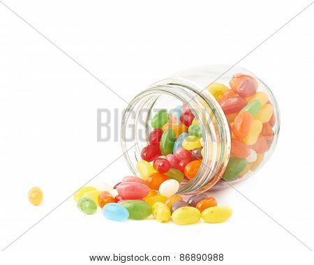Jelly bean candies spilled out of jar
