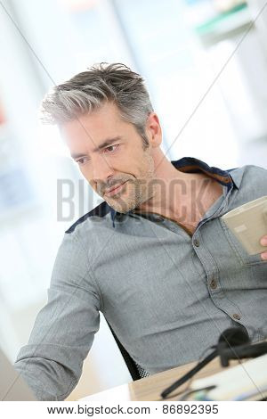 Businessman working form home on laptop computer