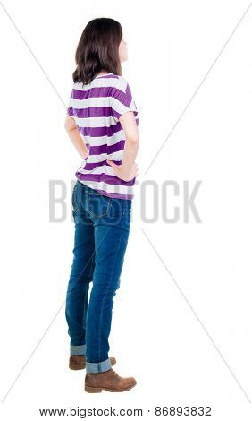 back view of standing young beautiful  brunette woman in yellow pullover. girl  watching. Rear view people collection.  backside view of person.  Isolated over white background.