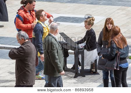 Young Lady Playing Electric Piano At Aristotelous Square