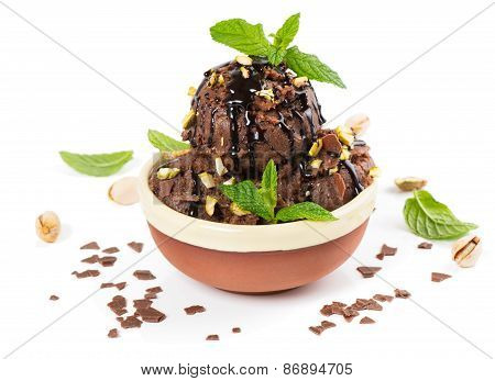 Chocolate Ice Cream Decorated With Mintand Sauce