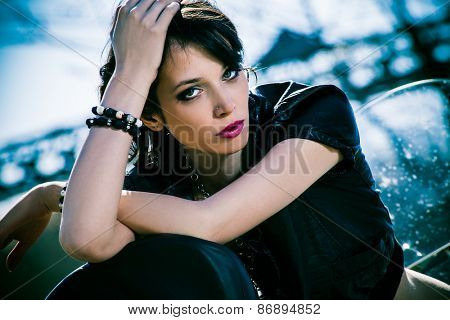 young beautiful woman sitting on motorbike,  outdoor at river port
