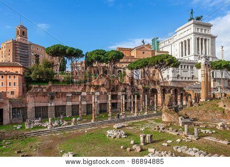 Ancient ruins of old roman forum and Victor Emmanuel II monument in Rome, Italy.
