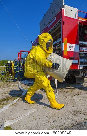 Man with briefcase in protective hazmat suit