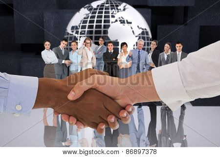 Close-up shot of a handshake in office against planet on black abstract background
