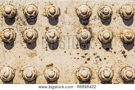 background texture of rusty nuts and bolts