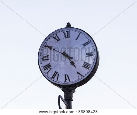 clock with reflection of tree branches