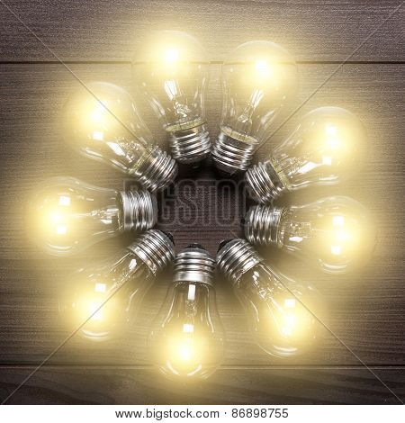 glowing bulbs on wooden table