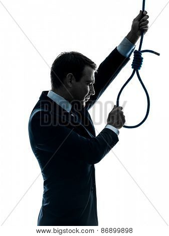 one  man holding adjusting hangman's noose in silhouette studio isolated on white background