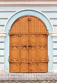 pic of building relief  - Old forged door in the wall of old building - JPG