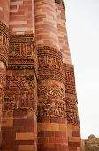 stock photo of qutub minar  - Carving details beautiful patterns on the outside walls of Qutub minar in Delhi - JPG