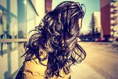 stock photo of windy weather  - Brunette girl with long curly hair outdoor windy weather - JPG