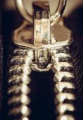 picture of zipper  - Macro shot of locking zipper on the clothes - JPG