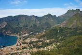 stock photo of off-shore  - Panoramic view of Cumberland Bay and the town of San Juan Bautista on Robinson Crusoe Island - JPG