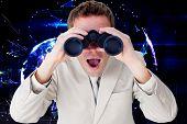 stock photo of binoculars  - Positive businessman using binoculars against global technology background in purple - JPG