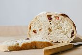 picture of whole-grain  - whole grain bread with cranberry on wooden cutting board - JPG