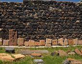 image of apostolic  - Row of broken khachkars next to the wall Sevanavank Armenia - JPG