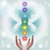 foto of qi  - Healing Hands and seven chakras on a sparkling pastel coloured background - JPG