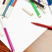 stock photo of marker pen  - Copyspace blank sheet of white paper covered with multiple colorful felt pen markers - JPG