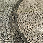 pic of cobblestone  - Urban road is paved with blocks of stone cobblestone walkway - JPG