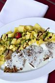 picture of veal  - Veal pasta parsley and cream sauce on a plate - JPG