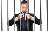 A Businessman In Jail Holding Bars