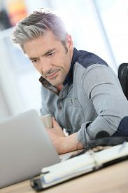 picture of stressless  - Businessman working form home on laptop computer - JPG