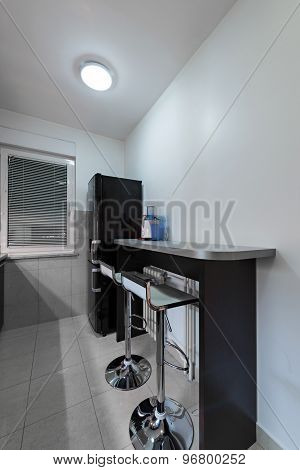 Counter With Bar Chairs In Kitchen Interior