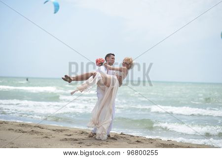 Smiling Wedding Couple On Beach