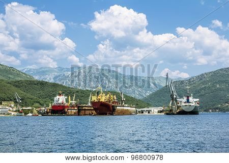 Ship-repair Docks With The Ships In The Bay Of Kotor. View From The Sea.
