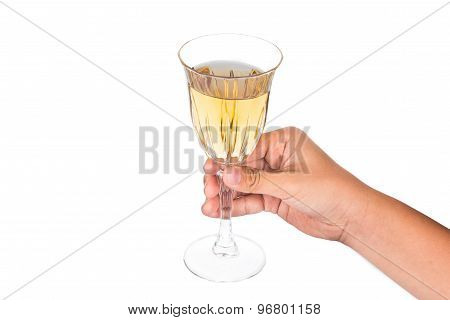 Hand holding white wine in crystal glass and ready to toast