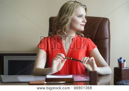 Smiling Business Woman In Chair