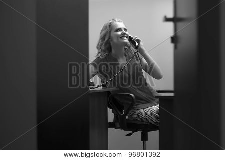 Smiling Female Secretary With Phone
