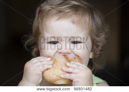 Hungry Little Boy With Bread Roll