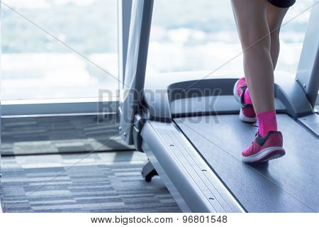 Unknown Woman  In Pink Shoes Running On Treadmill