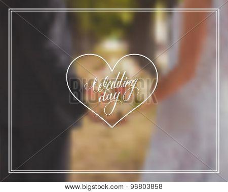 Wedding day typography element on blurred background.