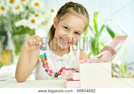 Cute Little girl with beads