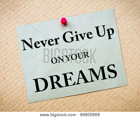 Never Give Up On Your Dreams Message Written On Paper Note