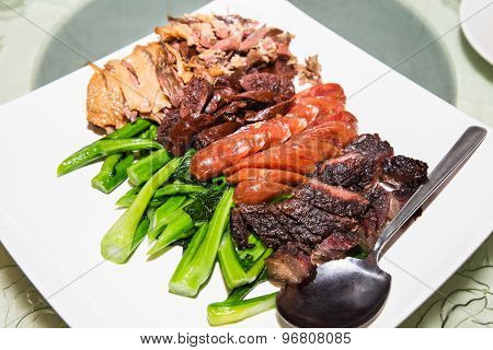 Waxed duck, sausage and preserved meat platter is a traditional delicacy taken by the Chinese