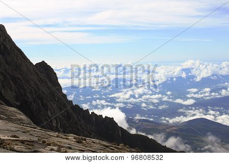 Sea of clouds against steep ascent while hiking to the summit of Mount Kinabalu in Sabah, Malaysia