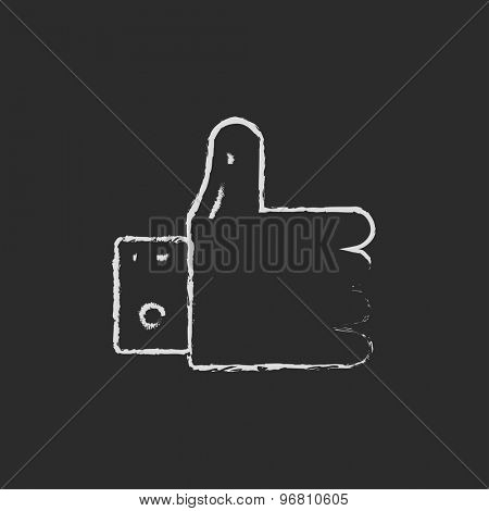 Thumbs up hand drawn in chalk on a blackboard vector white icon on a black background