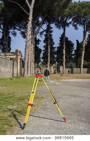 Surveyors At Pompeii Ruins In Italy