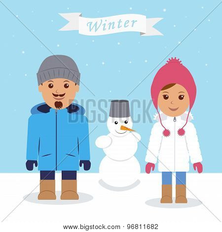 Winter fun. Young couple and snowman