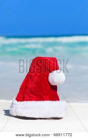 Santa Helper Hat On White Sandy Beach