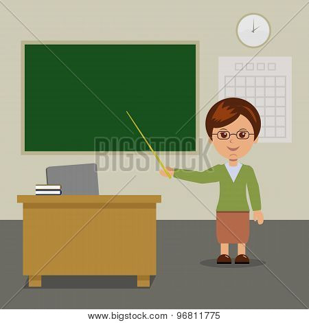 The teacher stands at the blackboard in class